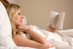 Reading in bed Stock Photos
