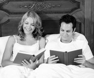 Reading in bed Royalty Free Stock Image