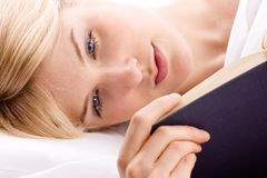 Reading in bed Royalty Free Stock Photo