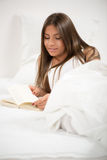 Reading in the bed Royalty Free Stock Images