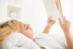 Reading in the bed Royalty Free Stock Photos