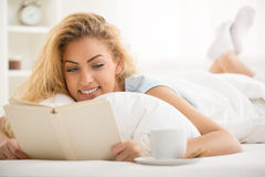 Reading in the bed Royalty Free Stock Image