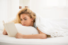 Reading in the bed Royalty Free Stock Photo