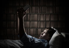 Reading in bed Royalty Free Stock Photography