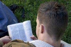 Reading Bible. Man reading Bible royalty free stock photography