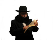 Reading the Bible. An Amish man reading the Bible over white Stock Image