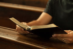 Reading Bible. Man reading Bible in a church Stock Photography