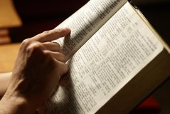 Reading Bible. Man reading Holy Bible in the church Royalty Free Stock Photos