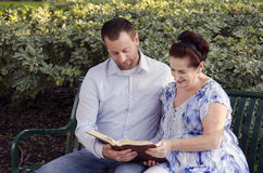 Reading the Bible together. Stock Photo