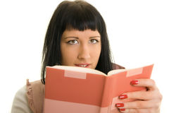 Reading Book. Girl on a white background, read a book Royalty Free Stock Photo