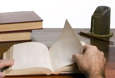 Reading a book. A person reads an open book. The pages are blank Royalty Free Stock Photography