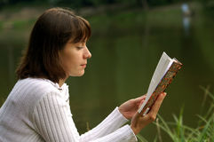 Reading a book. Young woman reading a book Royalty Free Stock Photography