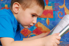 Reading the book. Little boy reading the book Royalty Free Stock Image