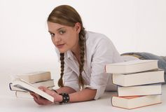 Reading a book. Cute young woman reading a book Stock Images
