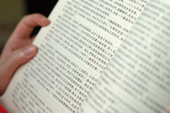 Reading book. It is a Chinese book, a girl is reading it Royalty Free Stock Photo