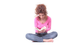 Reading a book. Happy woman reading a book isolated on white background Royalty Free Stock Image