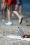 Reading book on the beach Stock Image