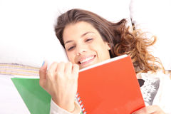 Reading a Book in Bed Royalty Free Stock Photo