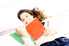 Reading a Book in Bed Stock Image