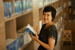 reading a book in bookshop or library Royalty Free Stock Photos