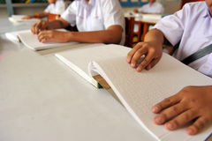 Reading the book Braille Royalty Free Stock Photography