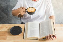 Reading book with coffee Royalty Free Stock Image