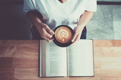 Reading book with coffee Stock Image