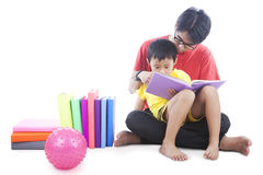 Reading a book with dad Royalty Free Stock Photos