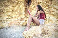Reading a book in the desert Stock Images