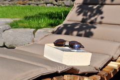 Reading a book in the garden royalty free stock photo