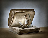 Reading a book. A girl is absorbed in reading a book royalty free stock photo