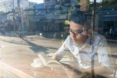 Reading book is really a good habit. For the youth stock photo