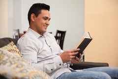 Reading a book at home Royalty Free Stock Photography