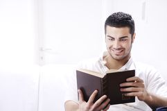 Reading book in home interior Stock Photo
