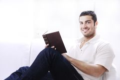 Reading book in home interior Royalty Free Stock Photography
