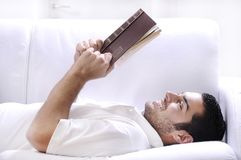 Reading book in home interior Royalty Free Stock Photos