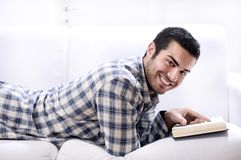 Reading book in home interior Royalty Free Stock Photo