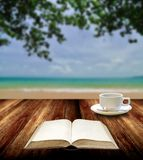 Reading book with hot cup at island. Relax concept Royalty Free Stock Photo