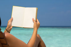 Free Reading Book In The Beach, Hands Holding Book With Blank Pages, Stock Image - 67011871