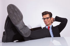 Reading book with legs on desk Stock Image