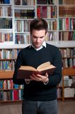 Reading book in library Royalty Free Stock Photography