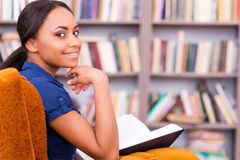 Reading a book in library. Royalty Free Stock Image