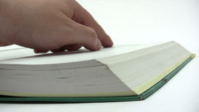 Reading in a Book. Male fingers pointing at the text in an open book and turning pages. Canon HV30. HD 16:9 1920 x 1080 at 25.00 fps. Progressive scan. Photo JPG stock footage