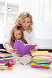 Reading a book with mom Royalty Free Stock Images