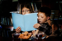 Reading book at night. Children reading book at night Stock Photography