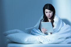 Reading book online Stock Photography