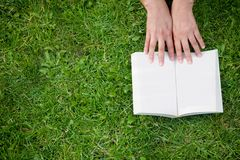 Reading a book outdoors Royalty Free Stock Photos