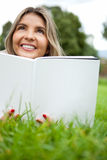Reading a book outdoors Royalty Free Stock Photography