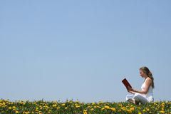 Reading a book outdoors Royalty Free Stock Photo