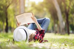 Reading a book at park stock photography